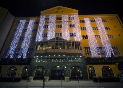Canal Court Hotel illuminated with ajc